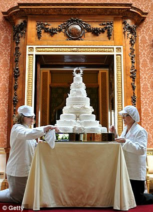 Rachel Jane Eardley, left, and Diane Pallett put the finishing touches to the royal wedding cake
