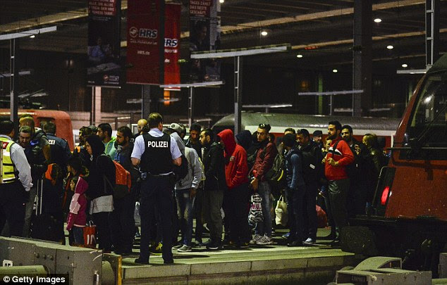 The incident is the latest violent coming together of asylum seekers and Germans to have come to light in recent weeks. Migrants are seen arriving by train at Munich Hauptbahnhof railway station on September 12 last year