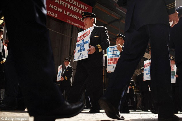 Uniform: Continental's ALPA unit announced the union rally, saying the company needed to 'get serious' about negotiating a joint contract
