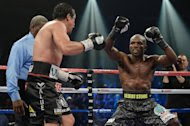 WBO welterweight champion Timothy Bradley (R) taunts Juan Manuel Marquez during their bout at the Thomas & Mack Center on October 12, 2013 in Las Vegas, Nevada