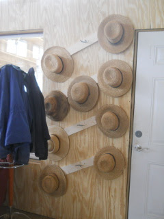 Hats on Homemade Amish Hat Rack During Fellowship Time