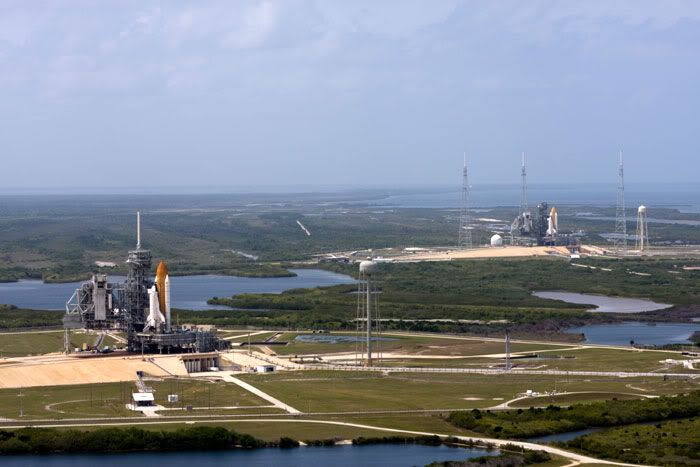 Space shuttle Endeavour (background) joins her sister Atlantis (foreground) at Launch Complex 39, on April 17, 2009.