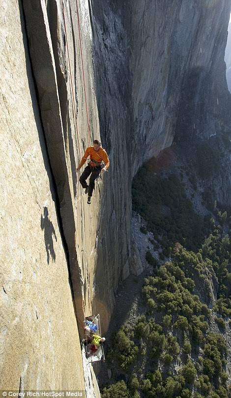 Tommy Caldwell hangs precariously after hammering in a piton to support his weight, and the weight of his wife, on the cliff