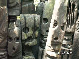 Faces carved into lumps of old wood