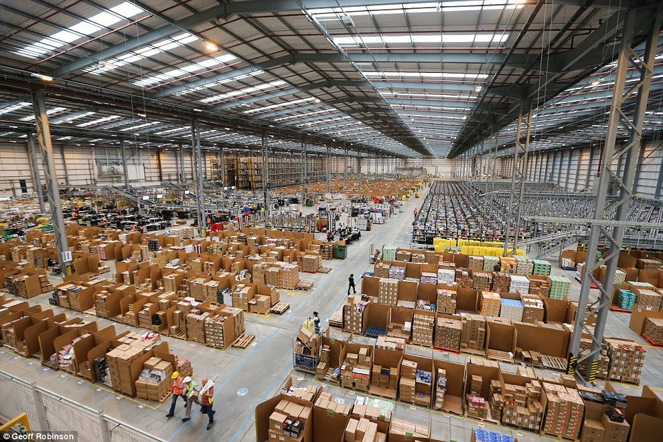Gearing up for Christmas: The enormous Amazon warehouse in Peterborough, Cambridgeshire, is already starting to fill up with thousands of boxes in preparation for the festive season