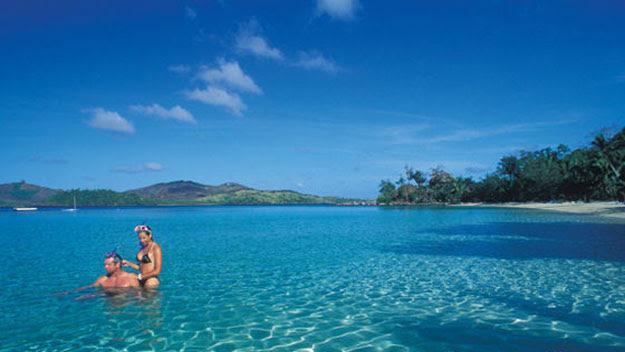 Couple swimming at Turtle Island, Fiji