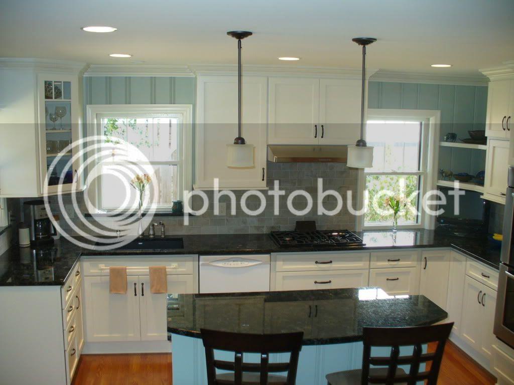 Cream Kitchen Cabinets with Dark Wood Floors