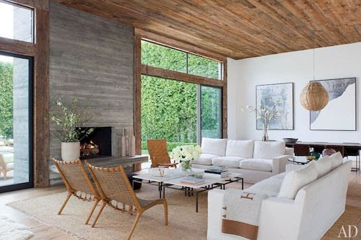 LE FASHION BLOG JENNI KAYNE CONTEMPORARY BEVERLY HILLS HOME ARCHITECTURAL DIGEST CALIFORNIA FASHION DESIGNER MID CENTURY MODERN EXPOSED RUSTIC WOOD PANEL CEILING WHITE SOFAS WOVEN RUG BLACK WHITE FOUR PIECE COFFEE TABLES WOOD WOVEN CHAIRS HERMES THROW BLANKET LONG DARK WOOD DINING TABLE LARGE FRAMED BLACK WHITE PORTRAITS HANGING WICKER WOVEN LIGHT SHADE GREY WOOD PANELED FIRE PLACE 5 photo LEFASHIONBLOGJENNIKAYNECONTEMPORARYBEVERLYHILLSHOMEARCHITECTURALDIGEST5.jpg
