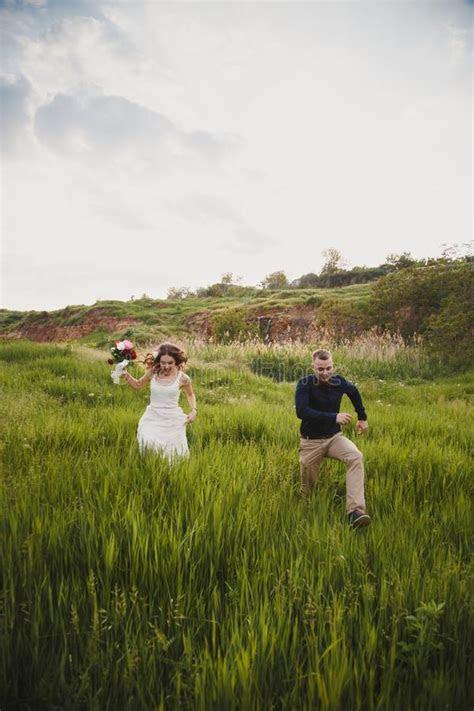 Running Newlyweds stock photo. Image of heterosexual