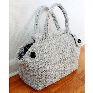 Free Crochet Bag pattern.  Wow!  I really like this bag.  The pattern includes detailed instructions, including how to make and attach the lining.