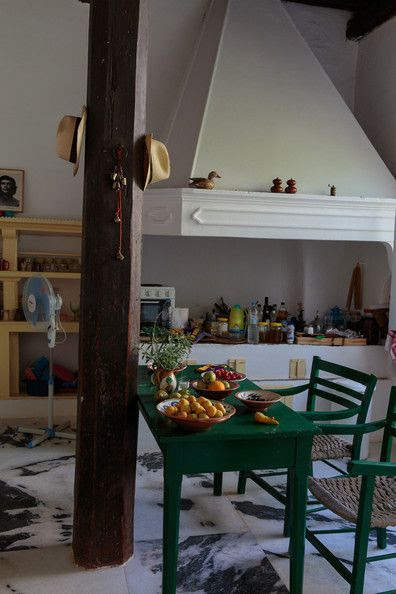 Bohemian Kitchen - Deeply veined marble floor tiles in an open kitchen