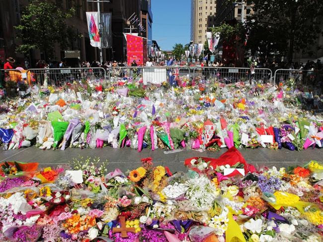 Sydneysiders pay their respect to the two hostages killed. Photo: Hollie Adams