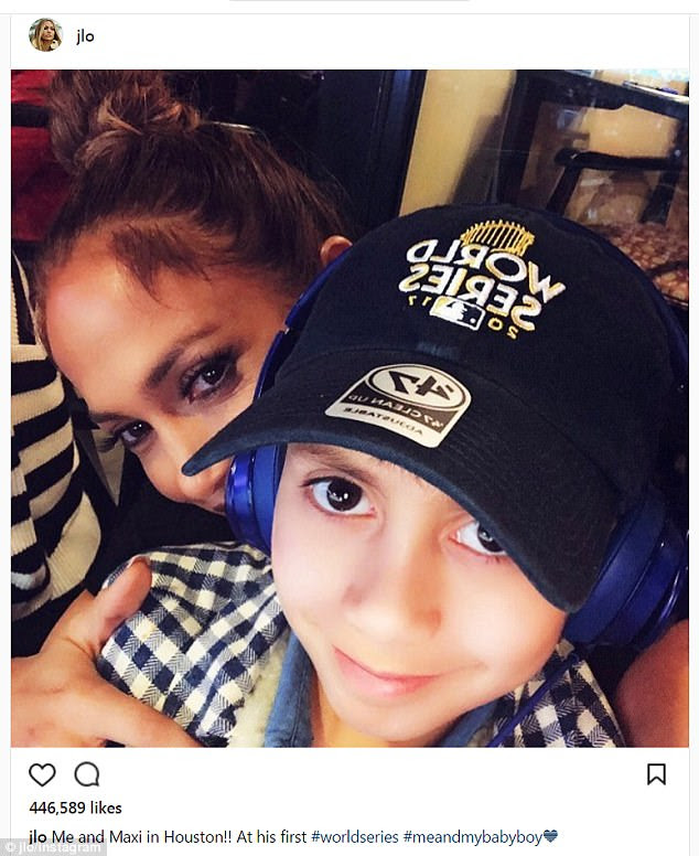 Her boy:Also with her was her son Max, who she had with singer Marc Anthony. He wore a blue-and-white check short and an official World Series baseball cap by '47