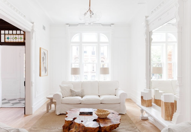 White living room with tree trunk table