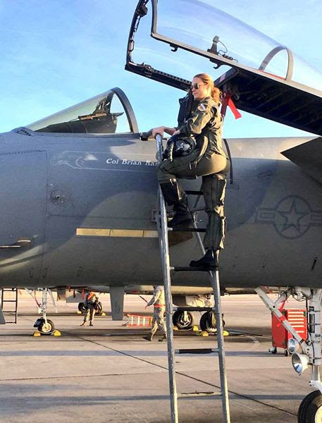 Brie Larson, who plays Carol Danvers in CAPTAIN MARVEL, poses near the cockpit of an F-15 Eagle fighter jet at Nellis Air Force Base in Nevada.