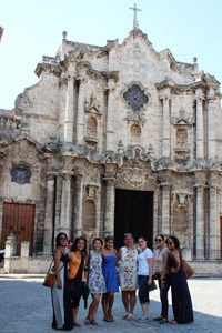 Photo: Courtesy of Connie Villanueva Elizabeth Amaya-Fernandez (center) with the students in front of the National Cathedral in Havana.