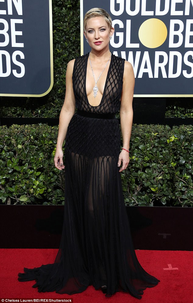Taking the plunge: Kate Hudson  turned heads on the red carpet at the 75th annual Golden Globe Awards at The Beverly Hilton in Los Angeles on Sunday