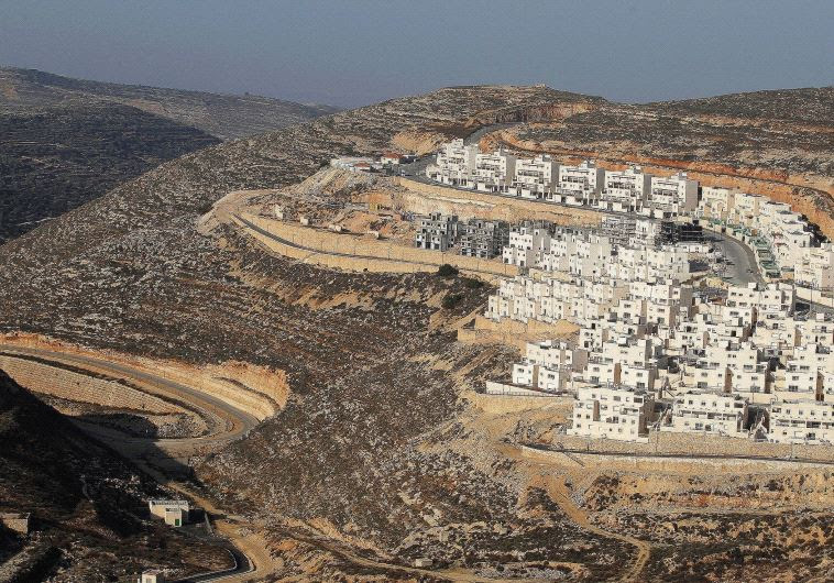 A CONSTRUCTION site in the West Bank settlement of Givat Ze'ev, near Jerusalem, in 2011