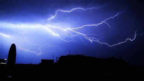 lightning storm  rolling thunder  rain   city