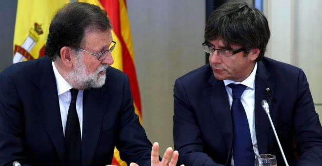 El presidente del Gobierno, Mariano Rajoy, y el presidente de la Generalitat de Cataluña, Carles Puigdemont / EFE