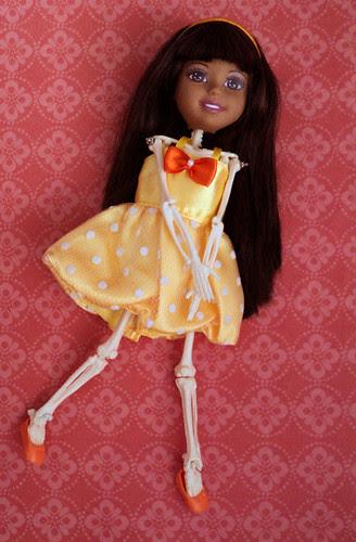 skeletal Black Ana in a yellow dress