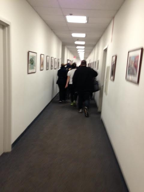 Newark students sprint down long eighth-floor hallway to get to Anderson's offices ahead of security officers