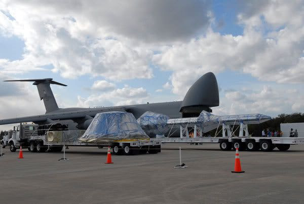 The boilerplate mockup of the Orion spacecraft is driven away after being transported to Kennedy Space Center by a C-5 Galaxy military aircraft.
