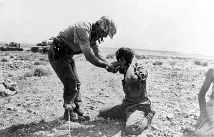 http://kypros.org/Occupied_Cyprus/cyprus1974/images/missings/turkish_officer_offering_cigar_700_bg.jpg