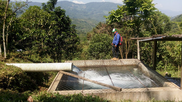 A man shows the 27-cubic-meter tank of the La Taña community hydropower system, one of four installed in this remote mountainous region populated mostly by indigenous people in the northwestern department of Quiché, Guatemala. Credit: Edgardo Ayala/IPS