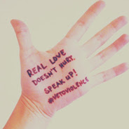 Palm of hand with writing - Real Love doesn't hurt. Speak up! #vetoviolence