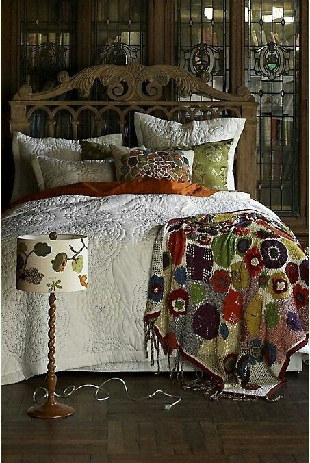 Love the quilted bed cover and the way the pillows are arranged-a good look for heavier winter bedding