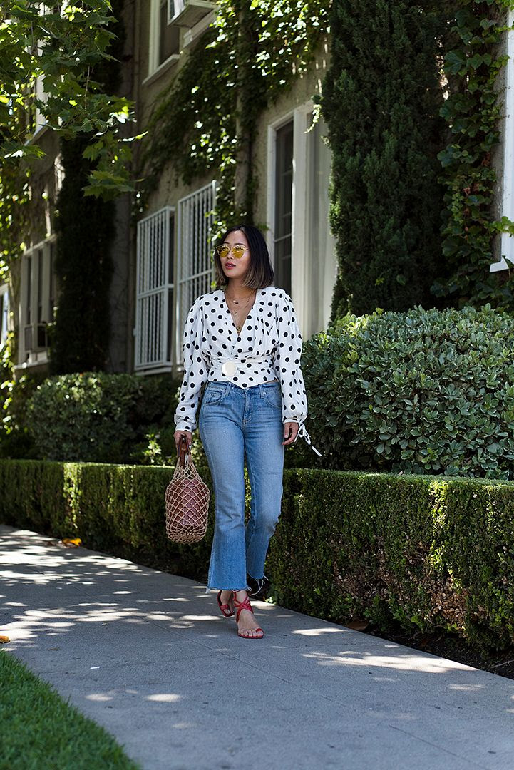 Le Fashion Blog Polka Dot Wrap Waist Blouse Cropped Jeans Red Heeled Sandals Via Song Of Style