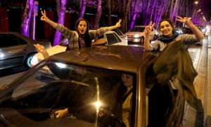 "Women flash the ""V for Victory"" sign as they celebrate on Valiasr street in northern Tehran after the announcement of an agreement on Iran nuclear talks."