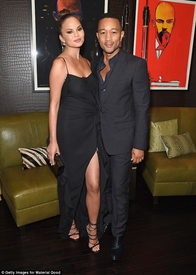 Lap of luxury: The couple wore matching black ensembles as they celebrated the boutique that sells the 'most exclusive of timepieces, jewelry, art, and accessories' in NYC