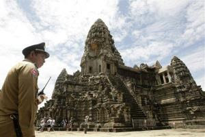 In this photo taken on June 28, 2012, a police officer stands guard at Cambodia's famed Angkor Wat temple complex in Siem Reap province.
