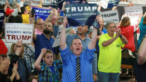 Supporters of United States Republican Presidential candidate Donald Trump scream at the media prior to the rally at the Charleston Civic Center on May 5, 2016 in Charleston, W. Va.