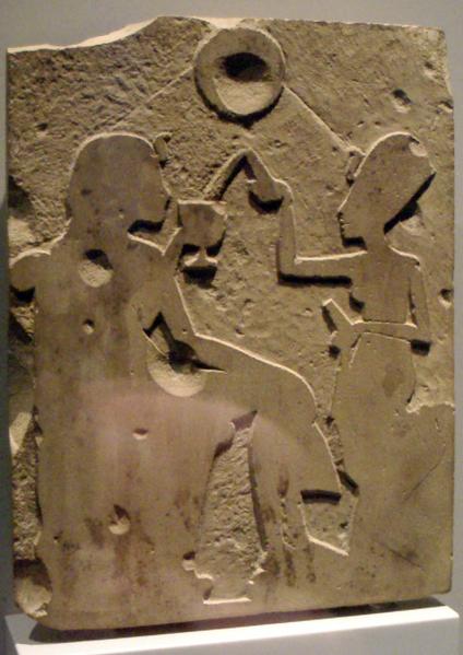 Nefertiti pours wine for Akhenaten