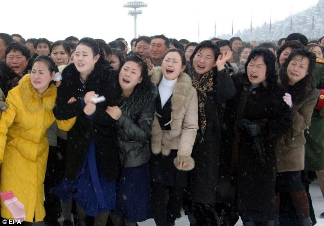 tears for 'Dear Leader': Women mourning during the state funeral procession of late North Korean leader Kim Jong-il, who died on 17th December 2011