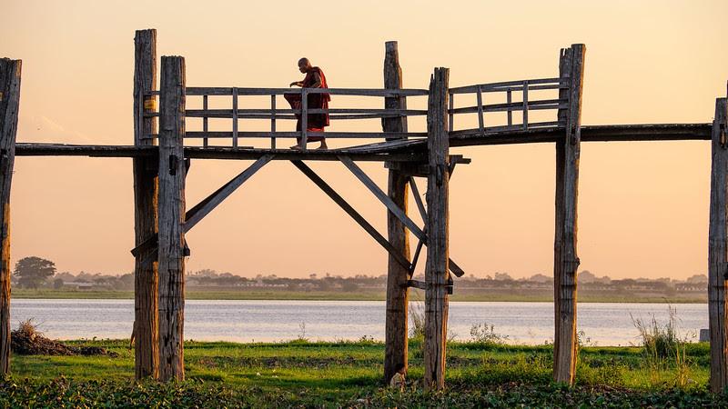Monk crossing the U Bein bridge