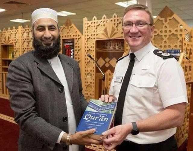 photo ian_hopkins_accepts_koran_zps2leaeqgm.jpg