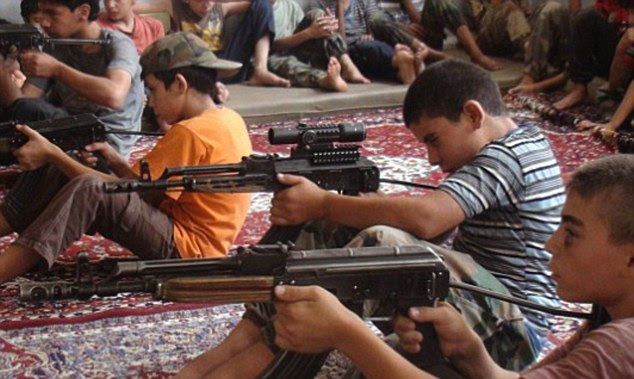 Brainwashed: ISIS uses training camps (pictured) and special schools to teach young children its twisted ideology