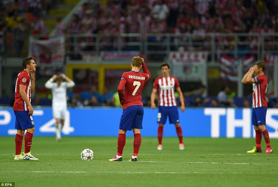 The Atletico Madrid players look dejected as they try to pick themselves up following the early setback in the San Siro on Saturday night