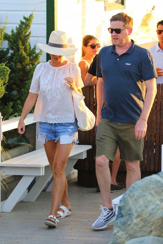 Le Fashion Blog Gwyneth Paltrow Wide Brim Hat Lace White Blouse Cut Off Denim Shorts White Birkenstock Sandals Via Vogue