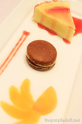 A Trio of Cheese Cake, Chocolate Macaron and Chilled Orange Compote