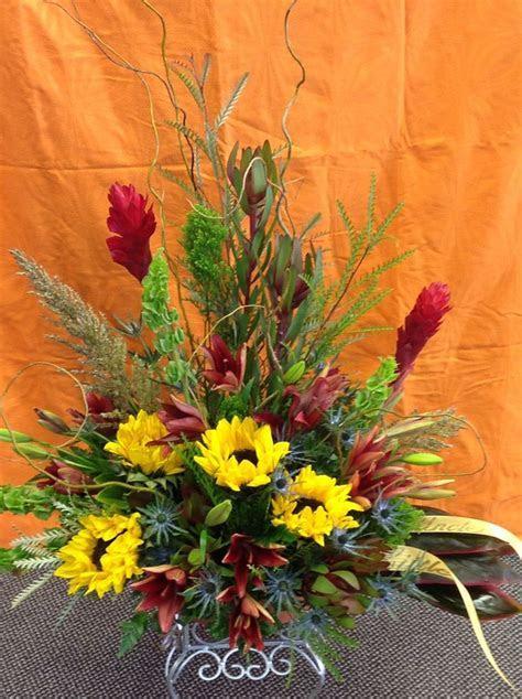Southwest looking funeral arrangement sunflowers. ginger