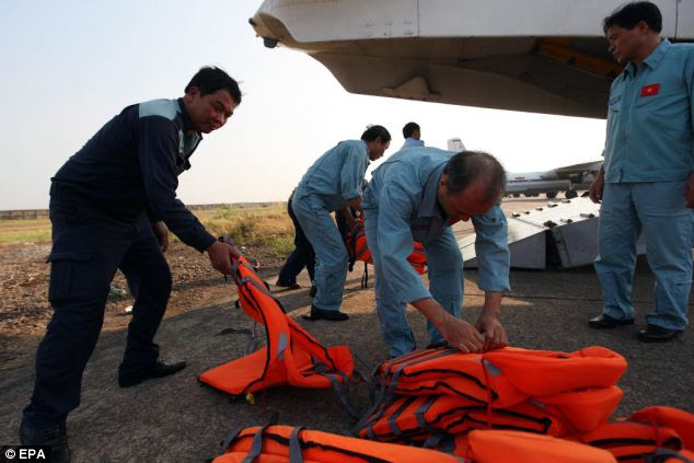 Life vests are prepared before search and rescue (SAR) operations for the missing Malaysian Airlines flight, at Tan Son Nhat international airport in Ho Chi Minh, Vietnam