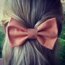 Dark salmon colored bow
