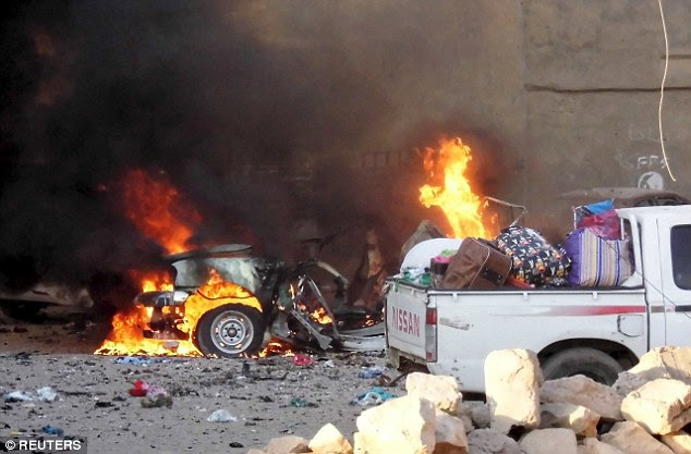 Carnage: ISIS  have taken full control of the Iraqi city of Ramadi after security forces fled the area following a series of suicide car bombings (pictured)