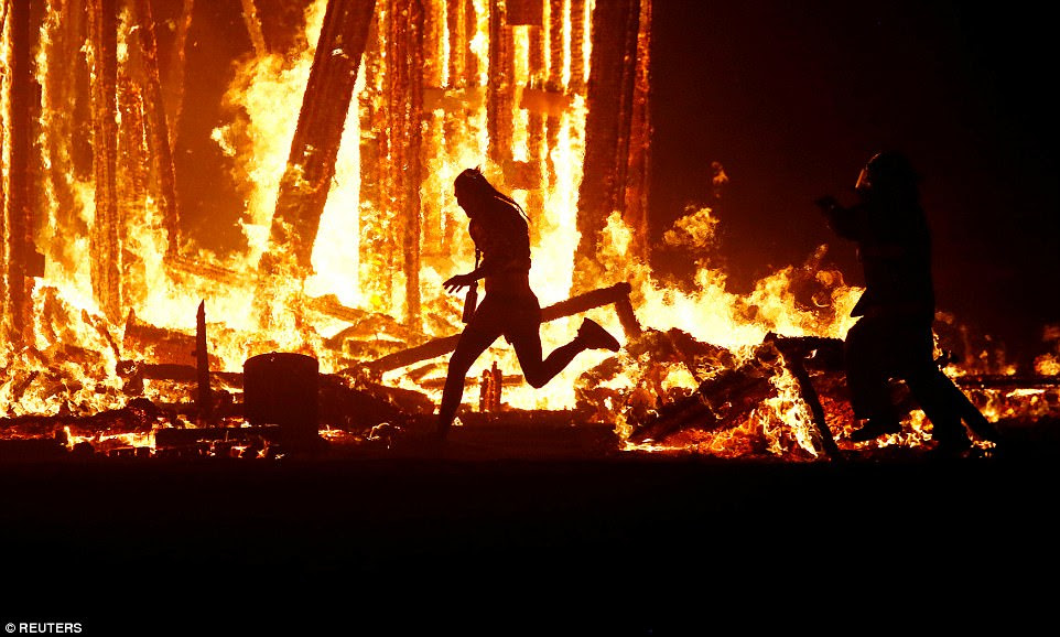A Burning Man participant died after evading the attempted tackles of multiple rangers and law enforcement personnel to run into the flames of the 'Man Burn' on Saturday night