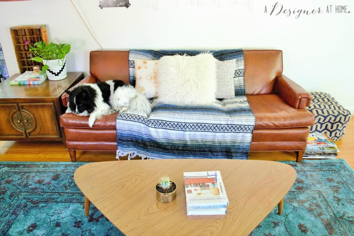 really cool vinyl sofa from the 50's a casually boho eclectic decorated space the living room of a 1950's brick ranch
